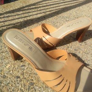 Ladies tan leather mules, size 7.5B.